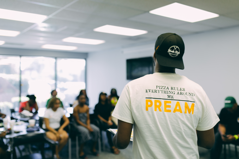 ej reed talking to pream scholarships winners